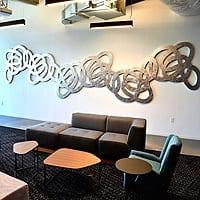 Dancing Knots   (Atlanta, GA installation)   Dimensions: 27' wide x 5' high   Medium: aluminum leaf on wood