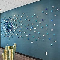 "Cluster Scattered A and B | Blue Wall – left (Tonawanda, NY installation) | Dimensions: 12' wide x 5' high | Medium: acrylic paint on (qty 195) 2"" wooden cubes 
