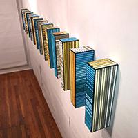 Plank II | Dimensions: (14) panels 13in H x 2.5in W x 4in D | Medium: acrylic on wood